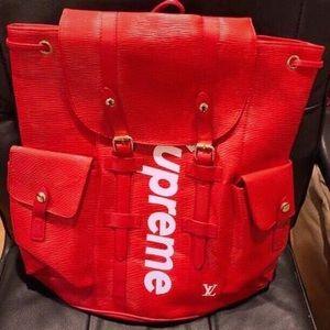 efdd0d8b53dd Louis Vuitton · LOUIS VUITTON X SUPREME Epi Christopher Backpack